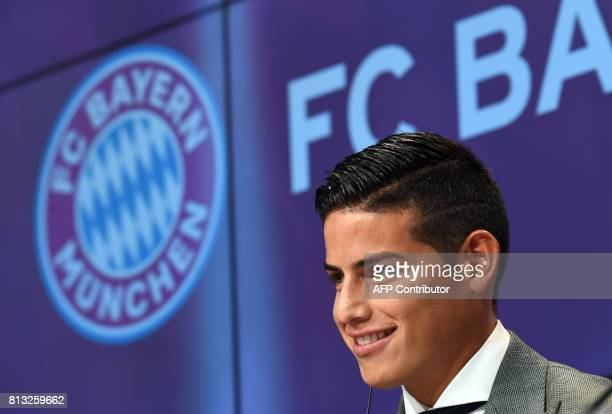 Colombian midfielder James Rodriguez new recruit of German first division Bundesliga football club Bayern Munich smiles during a press conference for...