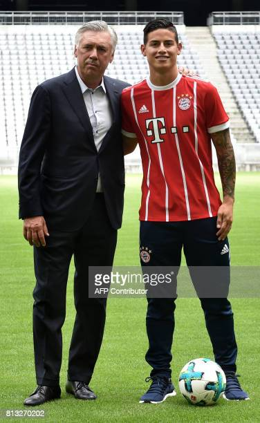 Colombian midfielder James Rodriguez new recruit of German first division Bundesliga football club Bayern Munich smiles as he poses with Bayern...