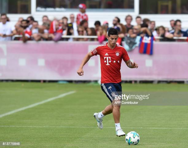 Colombian midfielder James Rodriguez new recruit of German first division Bundesliga football club Bayern Munich plays the ball during a training...