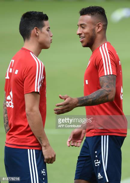 Colombian midfielder James Rodriguez new recruit of German first division Bundesliga football club Bayern Munich talks with Bayern Munich's new...