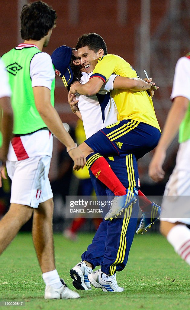 Colombian midfielder Juan Quintero celebrates with an assistant at the end of their South American U-20 final round football match at Malvinas Argentinas stadium in Mendoza, Argentina, on January 27, 2013. Four South American teams will qualify for the FIFA U-20 World Cup Turkey 2013. Colombia won 1-0.