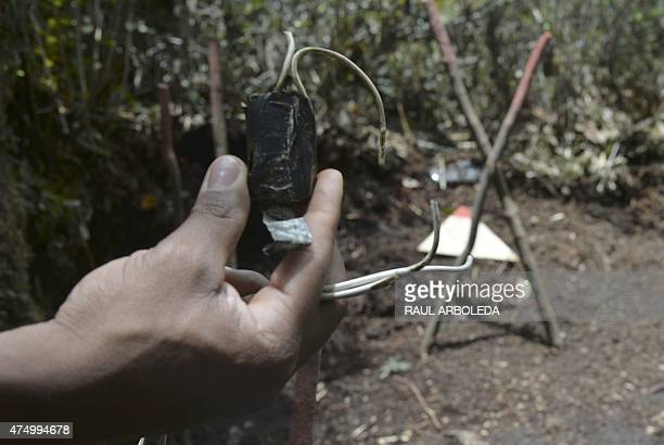 A Colombian minesweper shows a component of a landmine just removed in a minefield laid by guerrillas in La Virgen Carmen de Viboral Municipality...