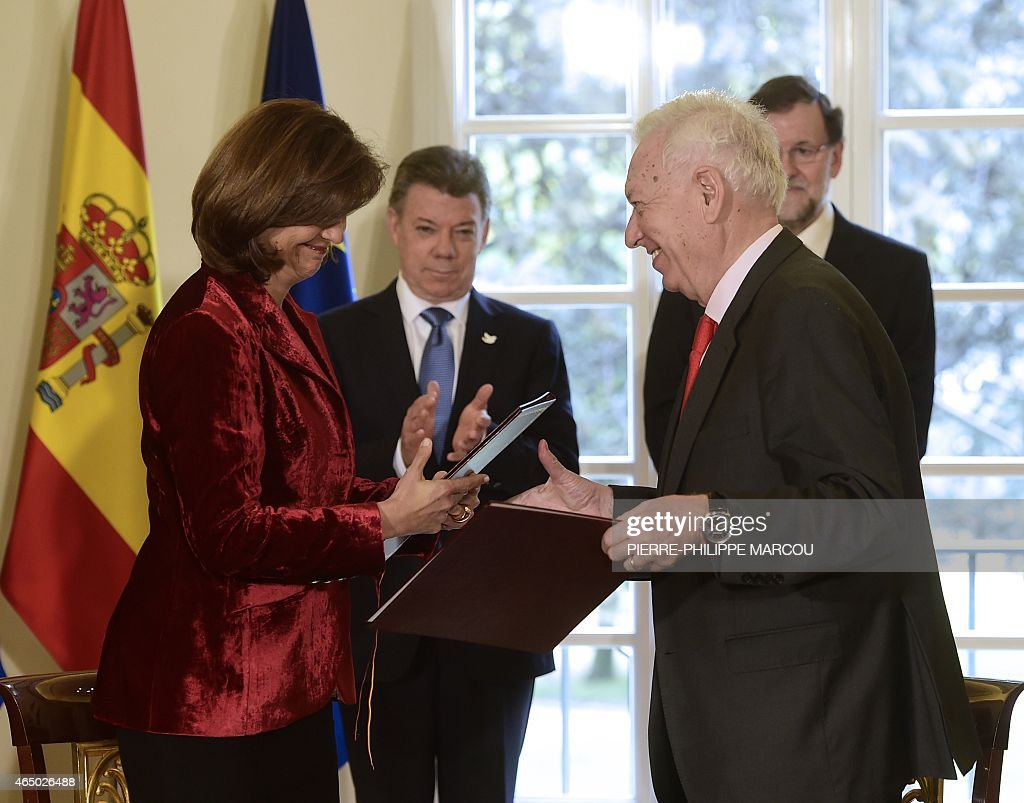 Colombian Minister of Foreign Relations <a gi-track='captionPersonalityLinkClicked' href=/galleries/search?phrase=Maria+Angela+Holguin&family=editorial&specificpeople=7133255 ng-click='$event.stopPropagation()'>Maria Angela Holguin</a> (L) and Spanish Minister of Foreign Affairs and Cooperation <a gi-track='captionPersonalityLinkClicked' href=/galleries/search?phrase=Jose+Manuel+Garcia+Margallo&family=editorial&specificpeople=8756020 ng-click='$event.stopPropagation()'>Jose Manuel Garcia Margallo</a> (2nd R) exchange documents in the presence of Spanish Prime Minister Mariano Rajoy (R) and Colombian President <a gi-track='captionPersonalityLinkClicked' href=/galleries/search?phrase=Juan+Manuel+Santos&family=editorial&specificpeople=974752 ng-click='$event.stopPropagation()'>Juan Manuel Santos</a> (2L) after signing several agreements at La Moncloa palace in Madrid on March 3, 2015. Former Colombian President Alvaro Uribe accused today Jose Manuel Santos of putting the army at the same level as terrorism after his decission of sending high army officers to negotiate with the FARC.