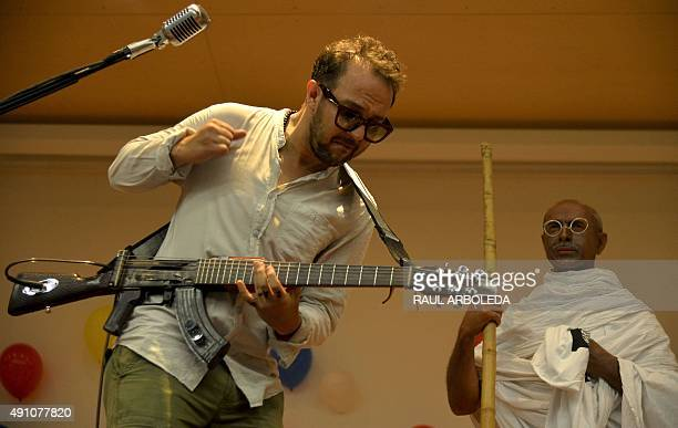 Colombian musician and human rights activist Cesar Lopez plays his 'Escopetarra' during the celebration of the Gandhi's 146th birth anniversary at...