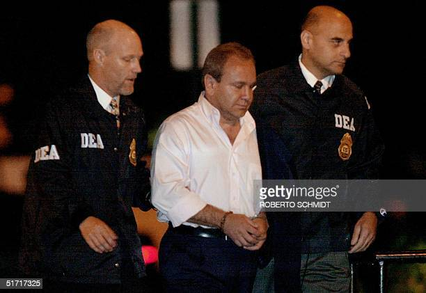Colombian national Alejandro Bernal is escorted by Drug Enforcement Special Agent Joe Kilmer and Assistant Special Agent in charge Fred Ganam into a...