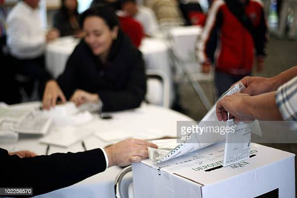A Colombian national casts a vote at a polling station set up in the residence of the Colombian ambassador in Quito Ecuador on June 20 during the...