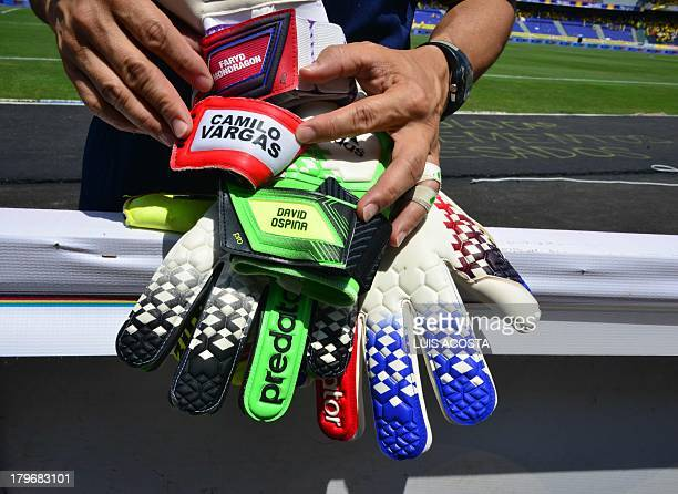 A Colombian national team assistant prepare the goalkeepers' gloves before the match against Ecuador for the FIFA World Cup Brazil 2014 qualifying...