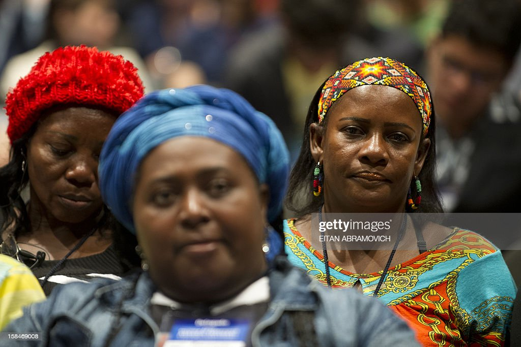 Colombian natives attend a forum on agricultural policy in Bogota, Colombia, on December 17, 2012, in the sidelines of the peace talks that Colombia's government and the FARC rebel group are holding in Cuba. AFP PHOTO/Eitan Abramovich