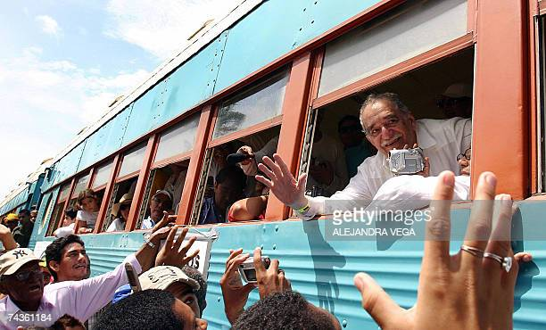 Colombian Nobel Prize for Literature 1982 Gabriel Garcia Marquez leans out of the window of the train upon arrival at his hometown Aracataca Colombia...