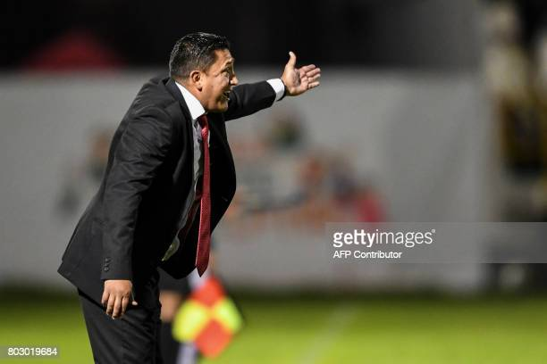 Colombian Patriotas coach Diego Corredor gives instructions to his players during their Copa Sudamericana football match against Brazilian...