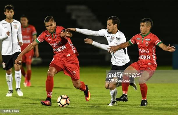 Colombian Patriotas midfielder Larry Vasquez vies for the ball with Brazilian Corinthians midfielder Rodriguinho and Colombian Patriotas midfielder...