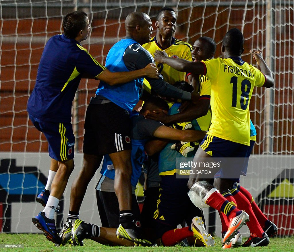 Colombian players celebrate at the end of their South American U-20 final round football match against Peru at Malvinas Argentinas stadium in Mendoza, Argentina, on January 27, 2013. Four South American teams will qualify for the FIFA U-20 World Cup Turkey 2013. Colombia won 1-0.