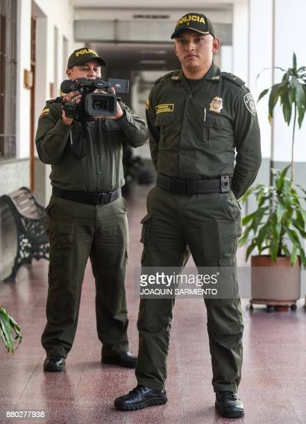 Colombian police chief Edinson Vanegas director of the documentary 'The Last Survivor' and second lieutenant Marlon Lengua pose for a photograph at...