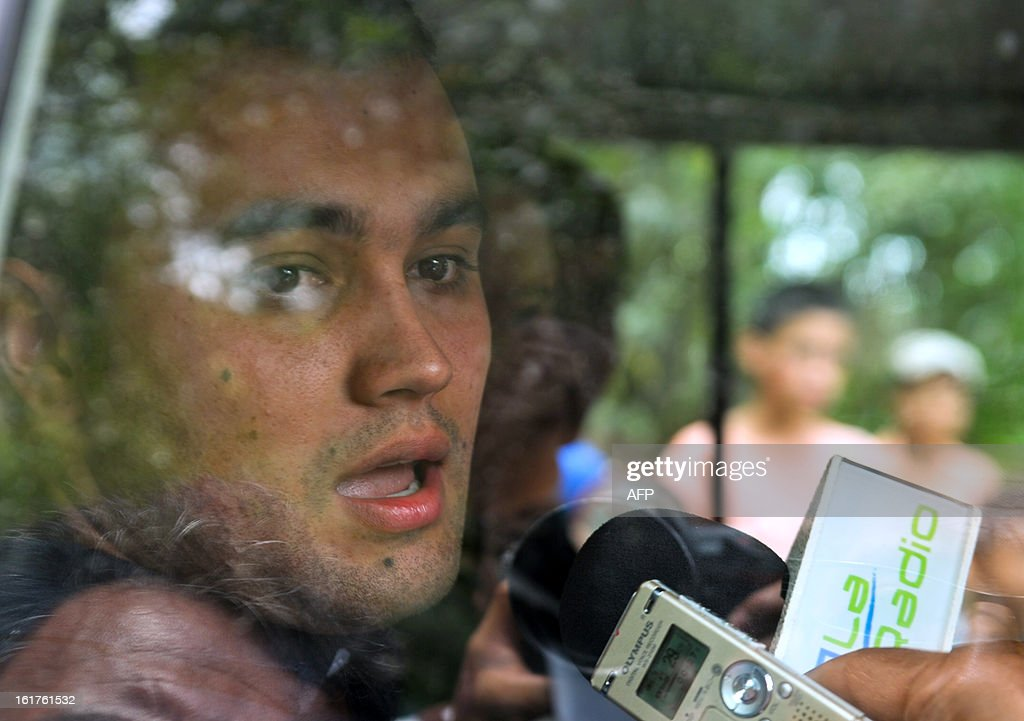 Colombian police officer Victor Alfonso Gonzalez (L) answers questions to journalists, from a vehicle of the International Red Cross, right after his release by the Revolutionary Armed Forces of Colombia (FARC), on February 15, 2013, in the village Montealegre, Cauca department, Colombia. Leftist Colombian guerrillas on Friday released two police officers they had held for three weeks, the International Committee of the Red Cross said. The men were released in a rural area in Cauca department in southwestern Colombia and were in good health, the ICRC said in a statement.
