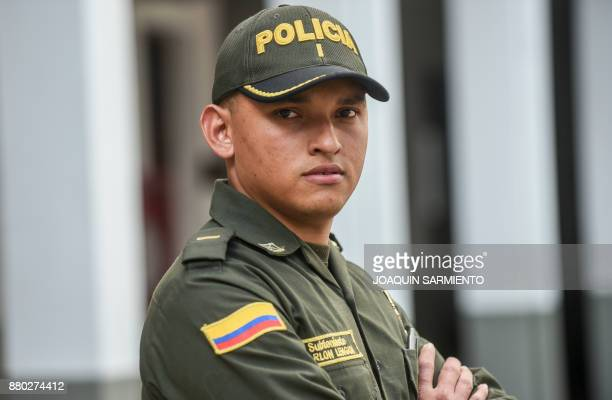Colombian police second lieutenant Marlon Lengua poses for a photograph at the Metropolitan Police headquarters in Medellin Colombia on November 25...