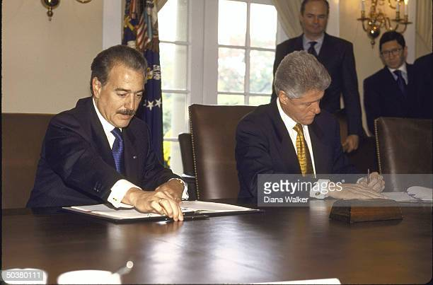 Colombian Pres Andres Pastrana Pres Bill Clinton during agreement signing ceremony at White House