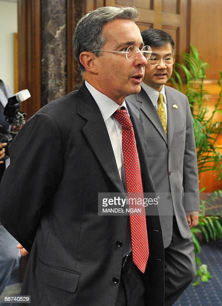 Colombian President Alvaro Uribe and US Commerce Secretary Gary Locke make their way to pose for a photo ahead of a meeting at the Commerce...