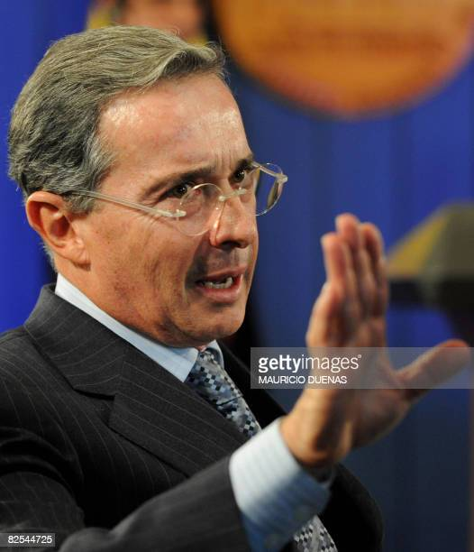 Colombian President Alvaro Uribe gestures during a press conference on August 25 in Bogota AFP PHOTO/ Mauricio DUENAS