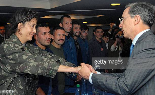 Colombian President Alvaro Uribe greets Colombian former presidential candidate Ingrid Betancourt in Bogota on July 2 2008 Betancourt three US...