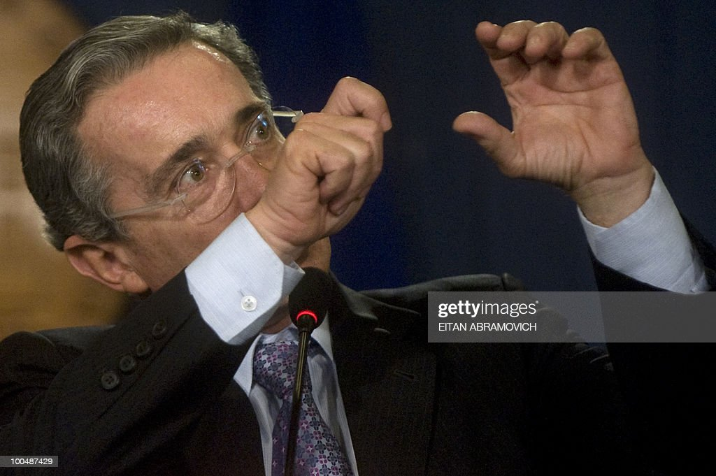 Colombian President Alvaro Uribe speaks during a press conference with his Honduran counterpart Porfirio Lobo (not depicted) at Narino Palace in Bogota on May 24, 2010. Lobo is on a two-day official visit. AFP PHOTO/Eitan Abramovich