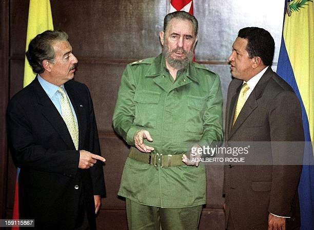 Colombian President Andres Pastran Cuban President Fidel Castro and Venezuelan Presidentelect Hugo Chavez talk before photographers at a photo...