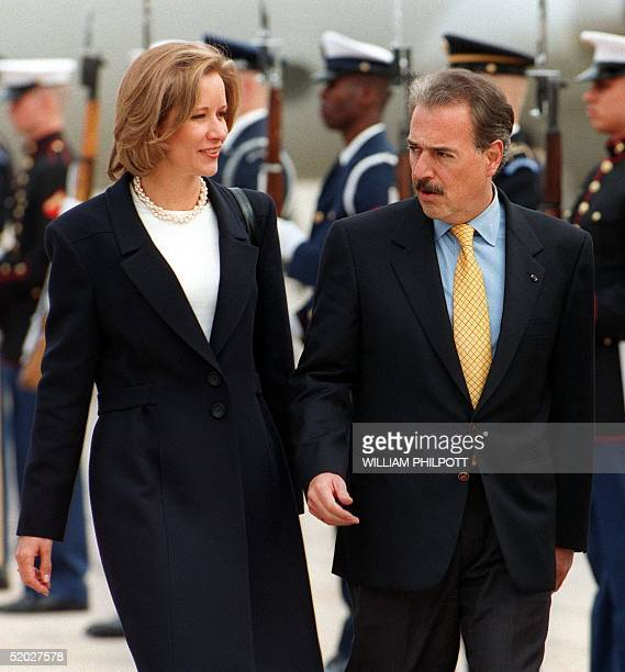 Colombian President Andres Pastrana and his wife Nohra review a guard of honor as they arrive 27 October at Andrews Air Force Base in Maryland...