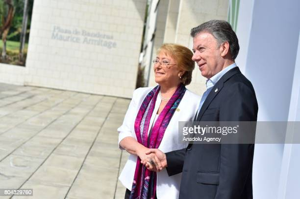 Colombian President Juan Manuel Santos and Chile's President Michelle Bachelet shake hands as they pose for a photo during the welcoming ceremony of...
