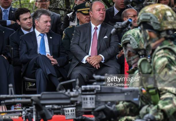 Colombian President Juan Manuel Santos and Defense Minister Luis Carlos Villegas attend a military parade to celebrate the 207th nniversary of the...