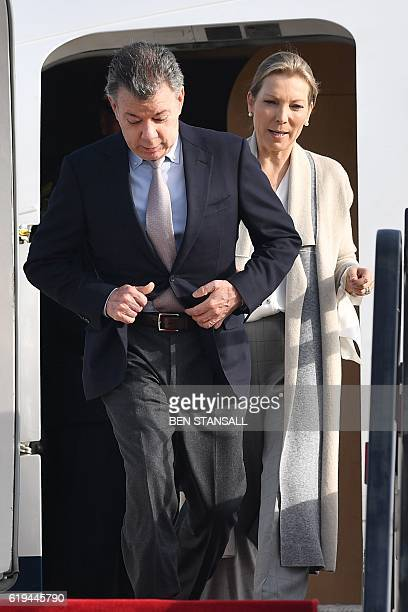 Colombian President Juan Manuel Santos and his wife Maria Clemencia Rodriguez arrive at London Stansted Airport in Essex north of London on October...