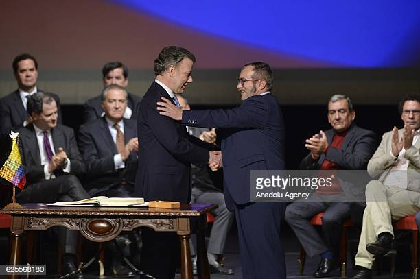 Colombian President Juan Manuel Santos and the head of the FARC guerrilla Timoleon Jimenez aka Timochenko are seen during the second signing ceremony...