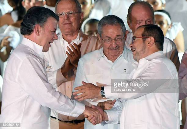 Colombian President Juan Manuel Santos and the leader of the FARC Rodrigo Londono better known by his nom de guerre Timoleon 'Timochenko' Jimenez...