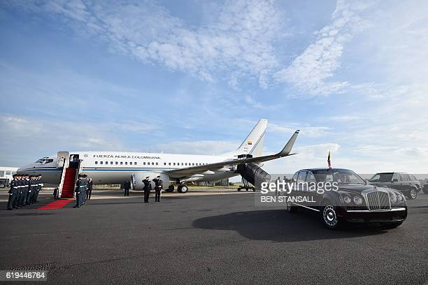 Colombian President Juan Manuel Santos and wife Maria Clemencia Rodriguez leave in Queen Elizabeth II's offical car with the President's Colombian...