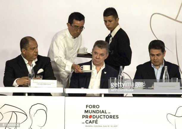 Colombian President Juan Manuel Santos Costa Rica's Luis Solis and Honduras' Juan Hernandez are pictured during the World Coffee Producers Forum in...