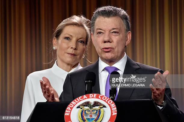 TOPSHOT Colombian president Juan Manuel Santos delivers a speech next to his wife Maria Clemencia Rodriguez after winning the Nobel Peace Prize 2016...