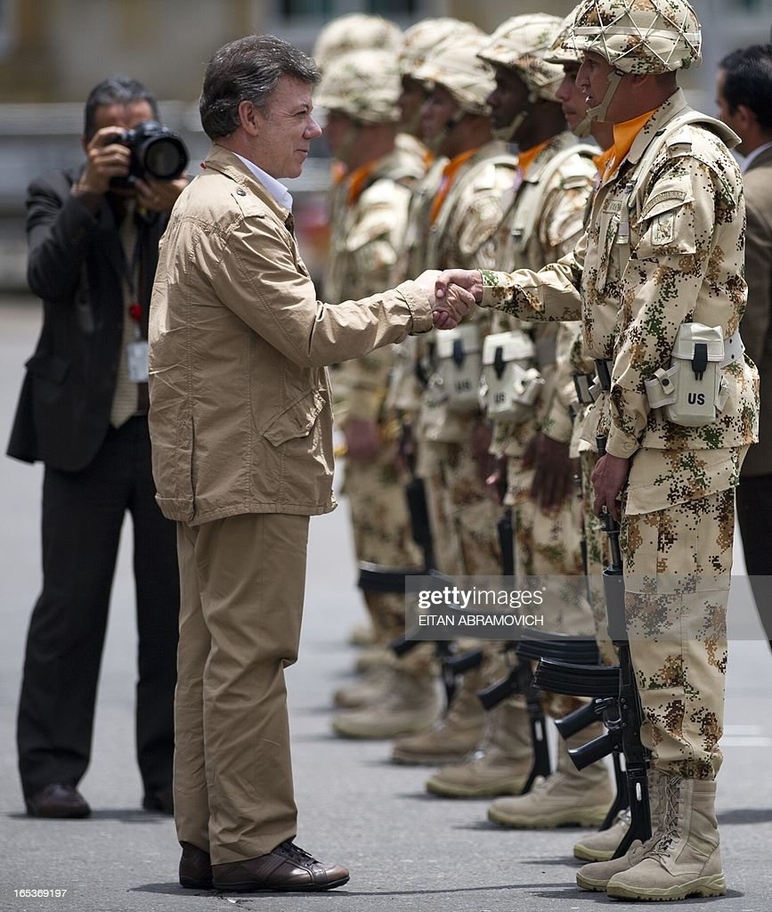Colombian President Juan Manuel Santos (L) greets Colombian infantry soldiers to be deployed as the Multinational Force and Observers (MFO) peacekeeping force in the Sinai peninsula during a military ceremony at Bolivar square in Bogota, Colombia, on April 03, 2013, to mark the 100th reshuffle of the MFO peacekeeping force overseeing the terms of the peace treaty between Egypt and Israel in the Sinai peninsula. AFP PHOTO/Eitan Abramovich