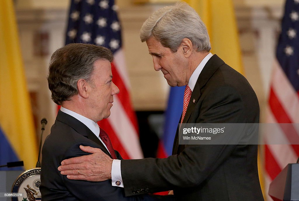 Colombian President Juan Manuel Santos (L) is embraced by U.S. Secretary of State John Kerry (R) following a joint press conference at the State Department on February 5, 2016 in Washington, DC. Kerry and Santos met and discussed the proposed 'Paz Colombia' plan earlier in the day.