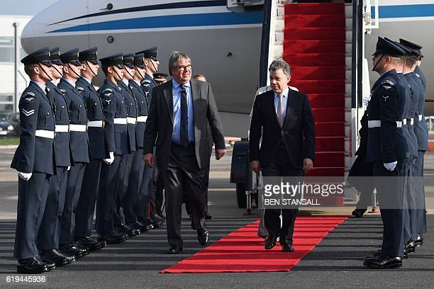 Colombian President Juan Manuel Santos is met by LordinWaiting Viscount Hood as he and his wife Maria Clemencia Rodriguez arrive at London Stansted...