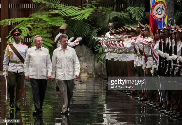 Colombian President Juan Manuel Santos is welcomed by his Cuban counterpart Raul Castro at Revolution Palace in Havana on July 17 2017 Santos is in...
