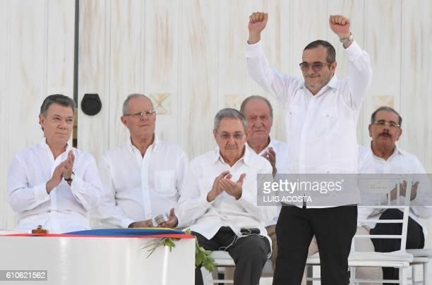 Colombian President Juan Manuel Santos looks as the leader of the FARC Rodrigo Londono better known by his nom de guerre Timoleon 'Timochenko'...