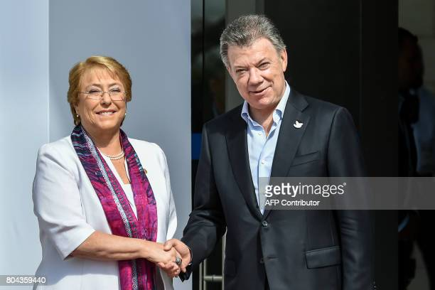 Colombian President Juan Manuel Santos shakes hands with his Chilean counterpart Michelle Bachelet during the welcoming ceremony of the XII Pacific...