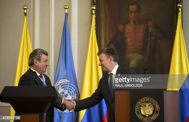 Colombian President Juan Manuel Santos shakes hands with Uruguay's ambassador to the United Nations Elbio Rosselli during a meeting at Narino Palace...