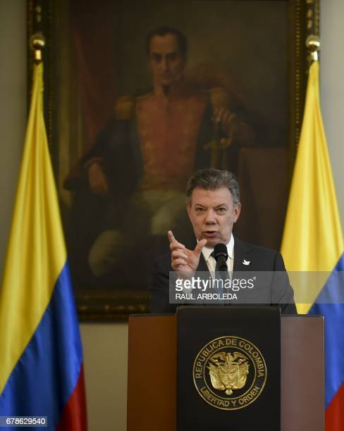 Colombian President Juan Manuel Santos speaks during a meeting with members of the United Nations Security Council at Narino Palace in Bogota on May...