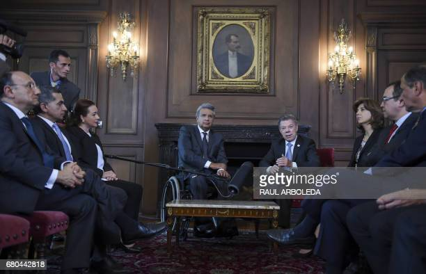 Colombian President Juan Manuel Santos speaks during a meeting with Ecuador's presidentelect Lenin Moreno next to Colombian Foreign Minister Maria...