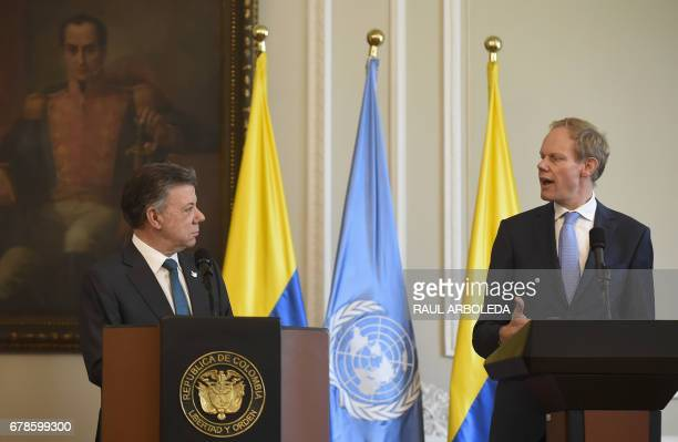 Colombian President Juan Manuel Santos speaks next to Great Britain's Ambassador at the UN Matthew Rycroft during a meeting at Narino Palace in...
