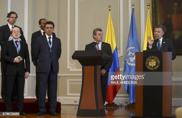 Colombian President Juan Manuel Santos speaks next to members of the United Nations Security Council during a meeting at Narino Palace in Bogota on...