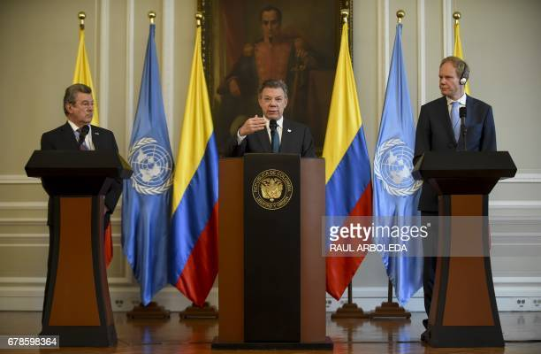 Colombian President Juan Manuel Santos speaks next to Uruguay's ambassador at the United Nations Elbio Rosselli and Great Britain's Ambassador at the...