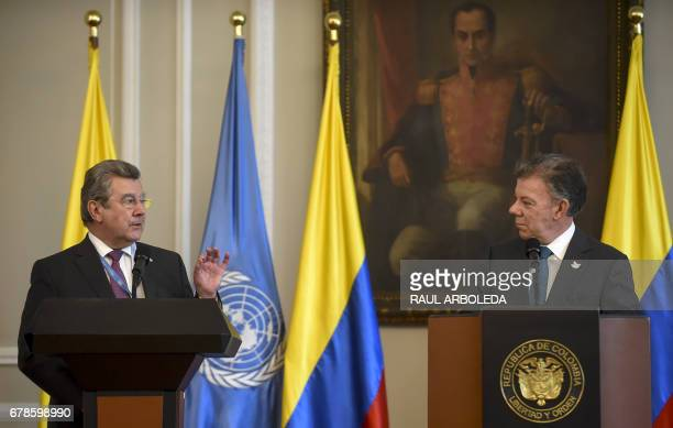 Colombian President Juan Manuel Santos speaks next to Uruguay's ambassador at the United Nations Elbio Rosselli during a meeting at Narino Palace in...
