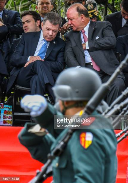 Colombian President Juan Manuel Santos talks whit Defense Minister Luis Carlos Villegas during a military parade to celebrate the 207th anniversary...