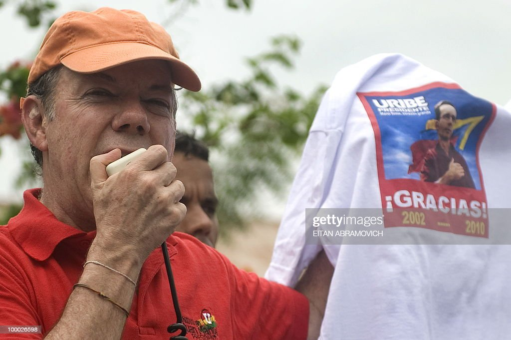 Colombian presidential candidate for the ruling National Unity party and former Defense Minister Juan Manuel Santos speaks during a rally in Aracataca, department of Magdalena, Colombia's Caribbean Region on May 20, 2010. Colombia will hold the presidential elections next May 30, and according to polls, a run-off election between Colombian presidential candidate for the Green Party, Antanas Mockus and Santos will take place on June 20.AFP PHOTO/Eitan Abramovich