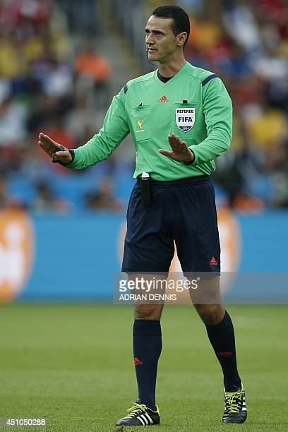 Colombian referee Wilmar Roldan gestures during a Group H football match between South Korea and Algeria at the BeiraRio Stadium in Porto Alegre...